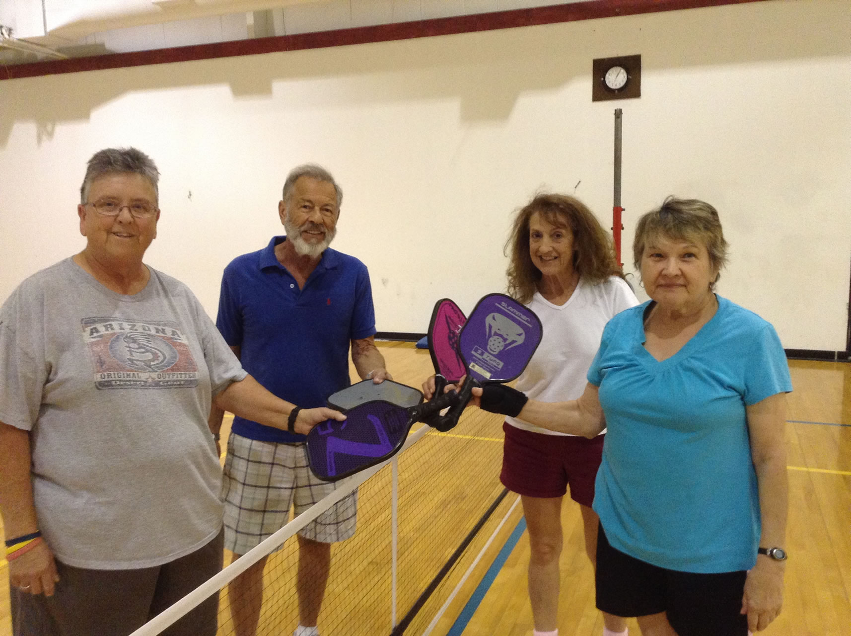 madison-turners-pickleball-four-players-smiling-at-the-net