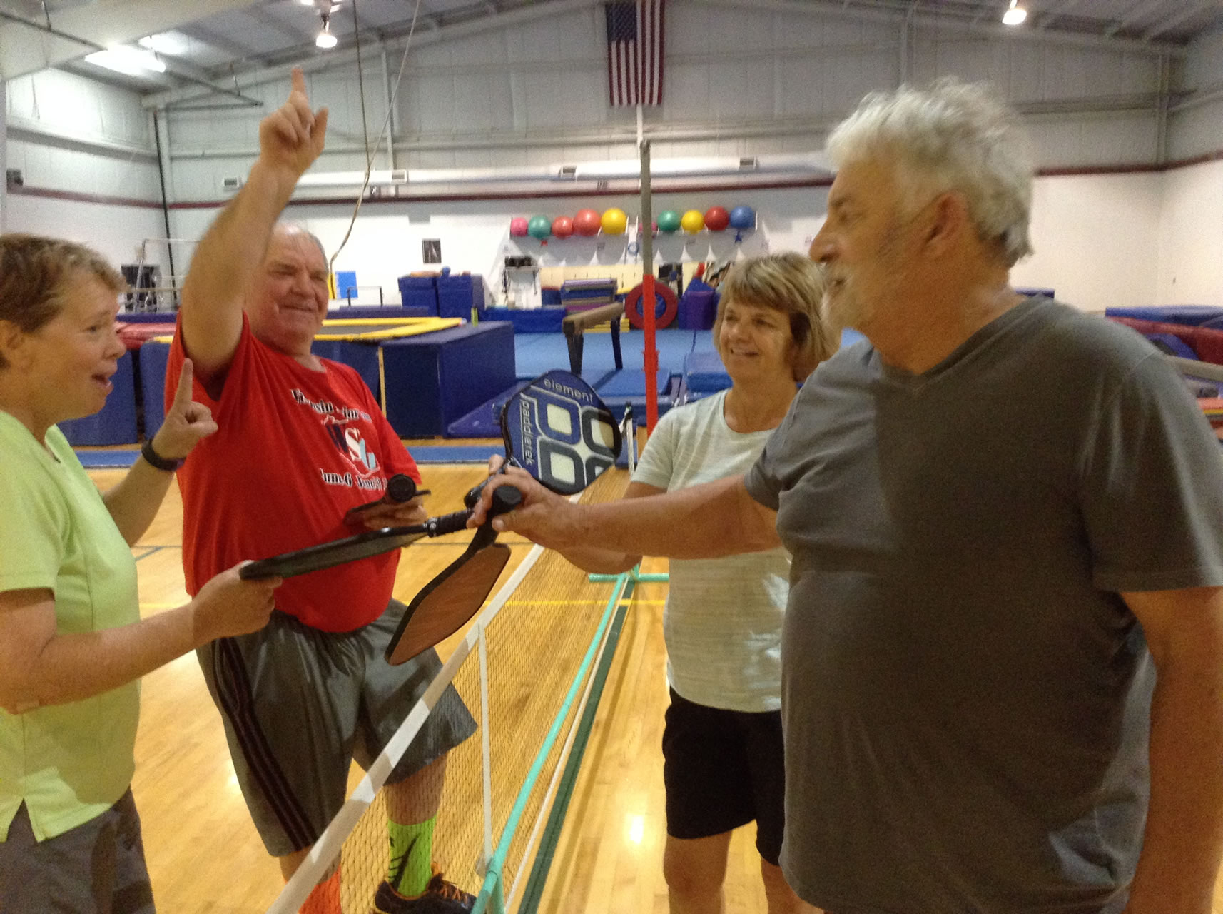 madison-turners-pickleball-players-meet-at-center-of-court