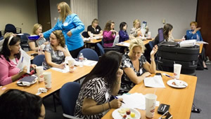 Training Seminar - people at tables learning