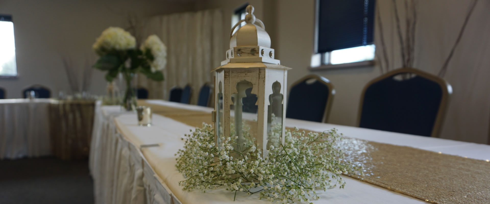 Picture of a centerpiece on the head table setup at a wedding reception held at Madison Turners