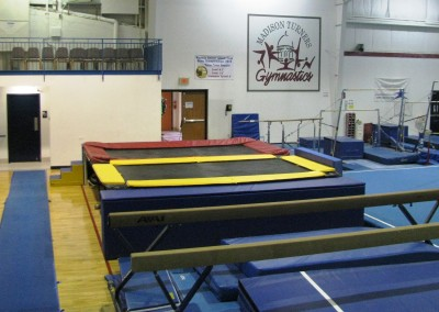 Picture of the trampoline and beam area of Madison Turners gymnastics