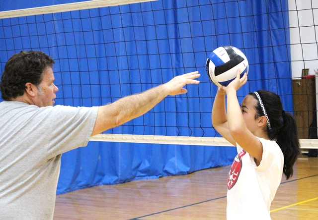 Young Volleyball student learns the right way to set the ball to the outside hitter